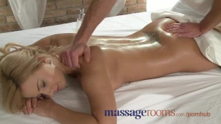 Screen Capture of Video Titled: Massage Rooms Tanned shaved busty young blonde intense orgasm