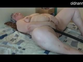Fat granny masturbating with long black dildo