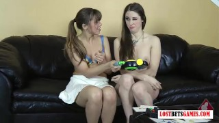 Screen Capture of Video Titled: Two cuties play series of games, first nude loses