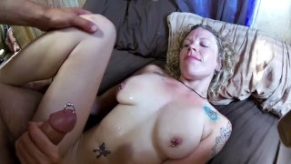 Screen Capture of Video Titled: Freshly pierced, swollen clit gets fucked