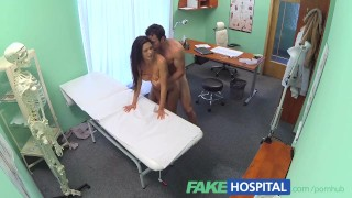 Screen Capture of Video Titled: FakeHospital Couple fuck in empty doctors office