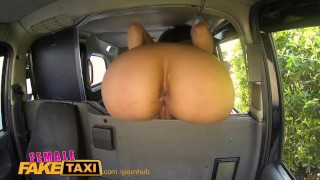 Screen Capture of Video Titled: FemaleFakeTaxi Fitness babe stretches her pussy