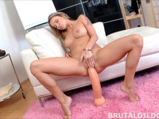 Blonde babe fucking her pussy with two massive dildos in HD