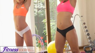 Screen Capture of Video Titled: FitnessRooms Two lesbian gym buddies having a sweaty workout