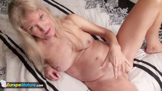 Mature granny blonde small tits showing nipples masturbating hairy pussy