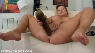 Big butt and huge breasted babe fucks her pussy with a massive dildo