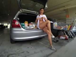 Amateur girl flashing her pussy and tits in a mall parking lot. WetKelly