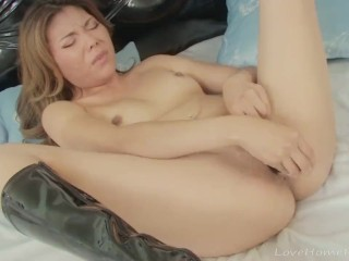 Beauty in black boots using her dildo