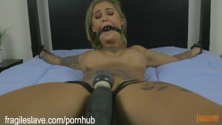 Screen Capture of Video Titled: Tattooed Mega Babe is Made to Cum