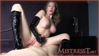MISTRESS WEARING ONLY GLOVES AND BOOTS HANDJOB