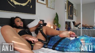 Asian Mistress edges her slave in bondage