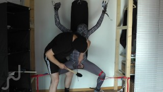 Ballbusting and electro on the balls of tied black Spiderman
