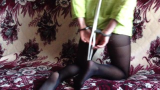 Screen Capture of Video Titled: Submissive girl in handcuffs and pantyhose nylon collar show myself