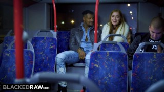 Screen Capture of Video Titled: BLACKEDRAW Two Beauties Fuck Giant BBC On Bus!