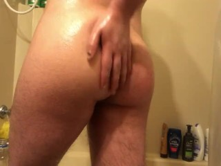 hairy ftm covered in oil plays with his ass and pussy