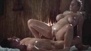Massage Rooms Sexy MILF with huge natural tits gives oily titwank