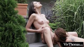 Cute lesbians get frisky in the garden