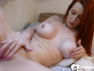 Redhead with big tits plays with her taco