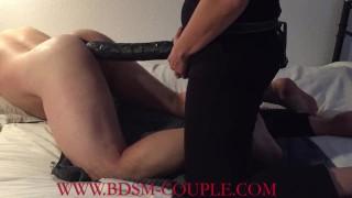 Miss M. fucks her slave HARD - impaling him on a 36 cm black rubber cock!