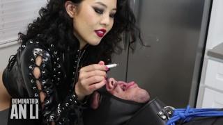 Rubber Mistress An Li uses her human ashtray