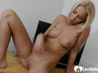 Blonde beauty with nice tits rubs her cunt