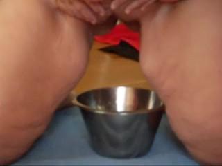 Jen is pissing into a Steel Bowl