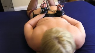 Hog tied and made to gag on a Dildo