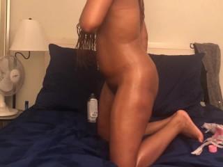 Pretty Ebony getting oiled up