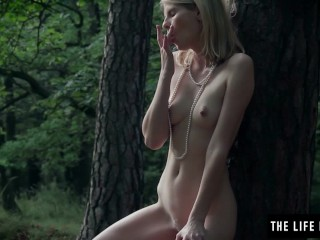 Skinny girl fucks herself hard in the forest