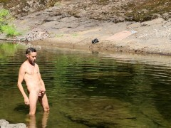 Jacking off big load of cum on a public river