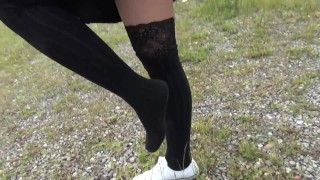 Screen Capture of Video Titled: Schoolgirl in black knee socks and white shoes show under the skirt