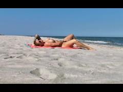 Kinky girl masturbating on the beach. WetKelly.