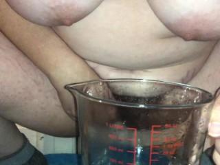 Close up piss into jar bbw
