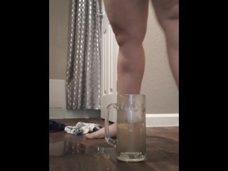 Dirty milf fills cup with pee