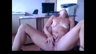 The secretary masturbates in the office
