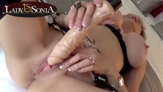 Mature blonde Lady Sonia uses a vior on her clit