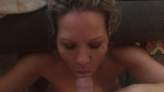Mommy gives blowjob in living room