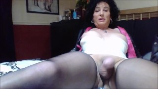 Old trans wanking his /her cock with hands and thighs short and free
