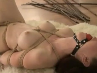 naked girl tied up and vibed on the floor