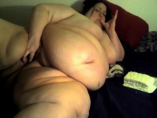 SSBBW eats cake and plays with fat pussy
