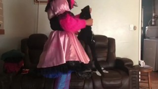 Sissy maid folds clothes