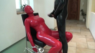 used Rubber Whore in Red Latex Catsuit And Mask Bounded Slapped Pissed