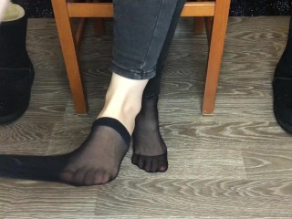 Student girl show nylon socks, boots and foot after study