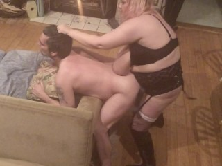 Pegging hubby 's ass while he 's bent over the couch