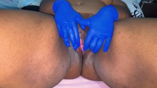 Ebony slut with gloves masturbates until she squirts a big load!