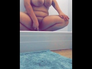 Busty Latina fucks herself with a hairbrush in shower