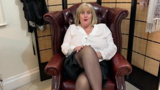 Filthy British Milf stuffs pantyhose in her wet pussy for a naughty gent.