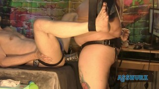 Tattooed Milf Gives Him a Pegging With A Tongue Biter Strapon