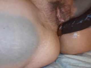 Making myself squirt over and over with my big black toy
