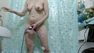 Girl washes a gentle body in the shower